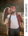 loving couple walks on the... | Shutterstock . vector #391368952