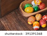 easter eggs hand painted on... | Shutterstock . vector #391391368