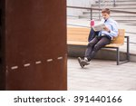 young man sitting on train... | Shutterstock . vector #391440166