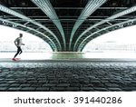 anonymous male athlete running... | Shutterstock . vector #391440286