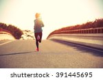 young fitness woman runner... | Shutterstock . vector #391445695