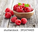 raspberry with leaves on a... | Shutterstock . vector #391474405