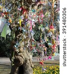 Small photo of AALST, BELGIUM, MARCH 13 2016: Pacifiers hanging on a special Pacifier Tree, which have been left behind by small children who don't need them anymore.