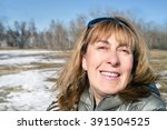 middle aged woman looking very... | Shutterstock . vector #391504525