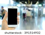 hand holding smartphone with... | Shutterstock . vector #391514932