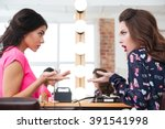 two pretty young women sitting... | Shutterstock . vector #391541998