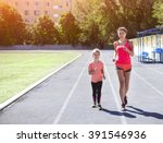 mother and little daughter are... | Shutterstock . vector #391546936