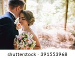 Stock photo bride and groom in a park kissing couple newlyweds bride and groom at a wedding in nature green 391553968