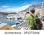 tourist in monaco taking photo... | Shutterstock . vector #391572646