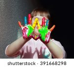 cute little girl with painted... | Shutterstock . vector #391668298