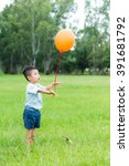 little kid relaese the orange... | Shutterstock . vector #391681792