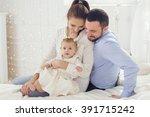 portrait of happy parents with... | Shutterstock . vector #391715242