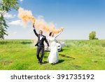 wedding couple with color smoke ... | Shutterstock . vector #391735192