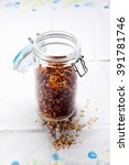 Small photo of granola in an airtight jar on a table with a tablecloth