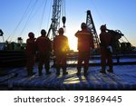 oil field oil workers at work | Shutterstock . vector #391869445