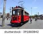 Small photo of ISTANBUL - JULY 3, 2013: Traditional red tram trundled along Istiklal Caddesi for 1.64 km (1 mile) connecting Taksim Square with Galatasaray and Tunel Square.