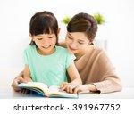 happy little girl looking at... | Shutterstock . vector #391967752