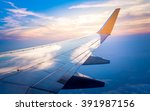 Airplane Wing With Sunrise In...