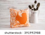 An Orange Accented Square Throw ...