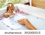 spa relaxation. woman body care.... | Shutterstock . vector #392000515