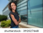 happy young african woman... | Shutterstock . vector #392027668
