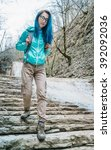 hiker young woman with backpack ... | Shutterstock . vector #392092036