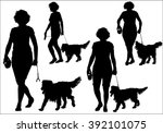 Stock vector a woman walking with a dog on a leash silhouette on a white background 392101075