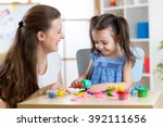 child girl with her mother... | Shutterstock . vector #392111656