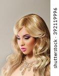 hair braid. beautiful woman... | Shutterstock . vector #392119996
