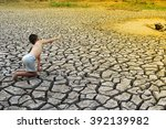 a boy  hand with a pond on dry...   Shutterstock . vector #392139982