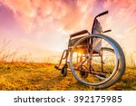 Empty wheelchair on the meadow...