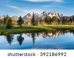 A Mountain Range with Its Reflection, Grand Teton National Park, USA.  Landscape is unique and part of Rocky Mountain. Grand Teton National Park is also popular among landscape and nature photographer