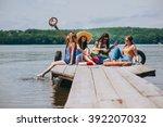 four beautiful girl friends on... | Shutterstock . vector #392207032