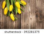 Fresh Yellow Tulips On Wooden...