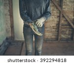 a young worker is standing in a ... | Shutterstock . vector #392294818