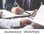 business adviser analyzing... | Shutterstock . vector #392429602