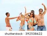beautiful young people having... | Shutterstock . vector #392538622