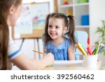 young woman or mother teaches... | Shutterstock . vector #392560462