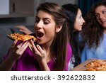 three girlfriends eating pizza... | Shutterstock . vector #392622832