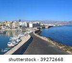 Seascape, Crete. Road through harbor. - stock photo
