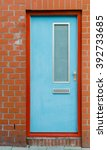 a light blue door contrasts... | Shutterstock . vector #392733685