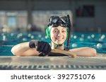 young underwater hockey player... | Shutterstock . vector #392751076