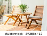 empty chair and table around... | Shutterstock . vector #392886412