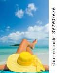 girl lies on the white sand on... | Shutterstock . vector #392907676