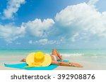 girl lies on the white sand on... | Shutterstock . vector #392908876