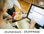 man paying with money in... | Shutterstock . vector #392999848