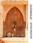 wooden door of an adobe  along... | Shutterstock . vector #393086242