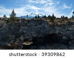 Pluto's cave with Mount Shasta in the background - stock photo