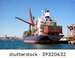 Cargo Ship Under Loading In Port