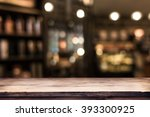 Stock photo blurred background of bar and dark brown desk space of retro wood 393300925